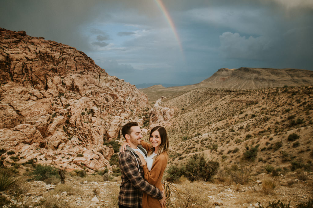 couple in vegas under a rainbow