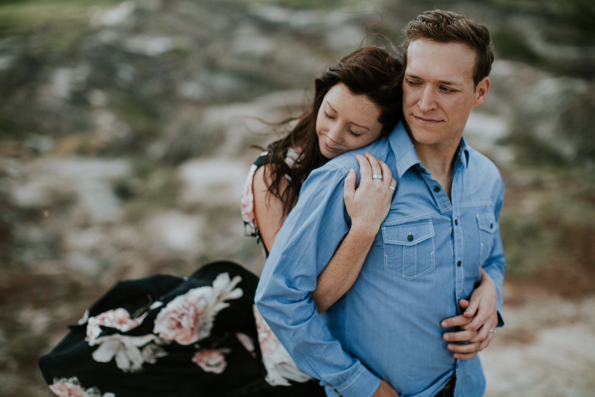 drumheller engagement photos - her dress is flowing in the wind