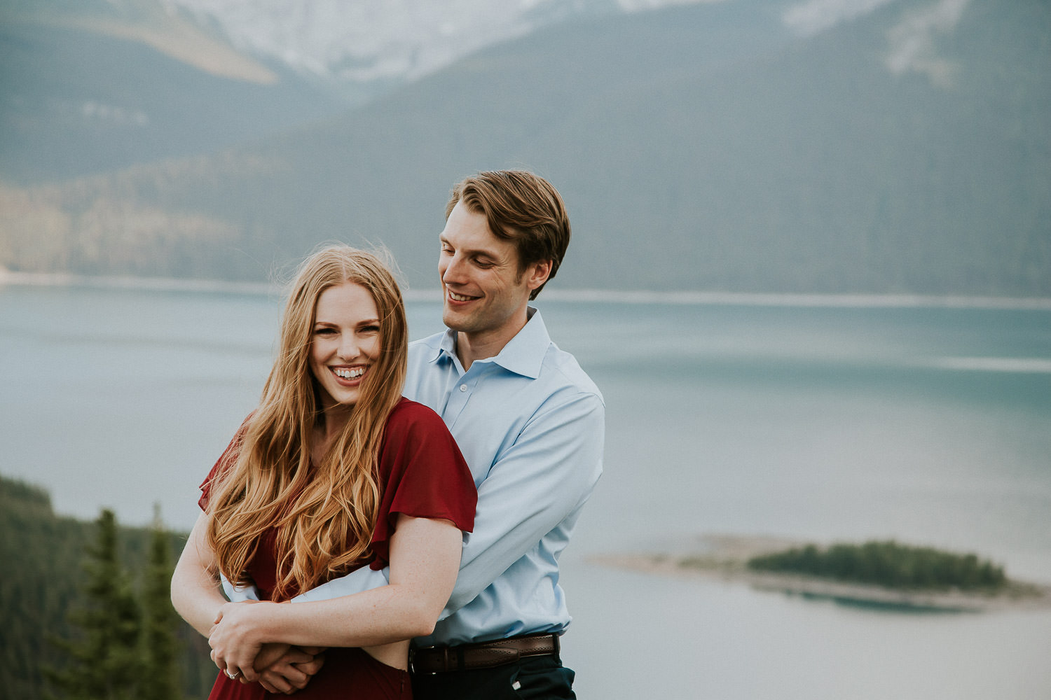 couple hugging in the Canadian Rockies for engagement photos - Sarah Pukin