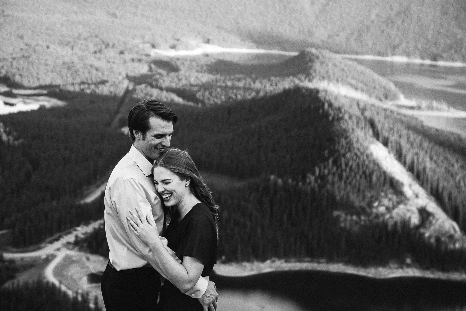 Couple Laughing at the top of a mountain in the Canadian Rockies - Sarah Pukin