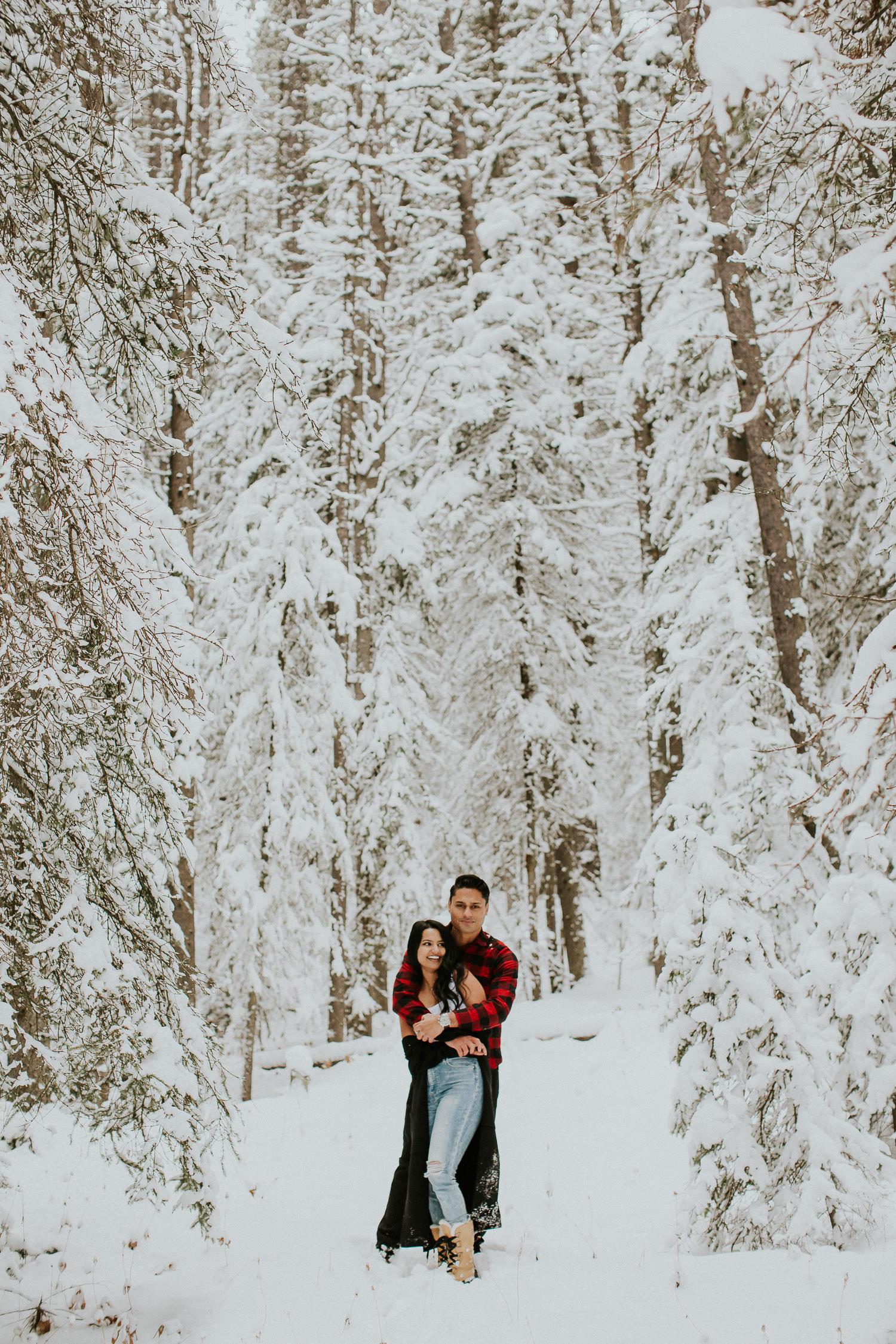 Playful Kananaskis Winter Engagement Photos - Sarah pukin