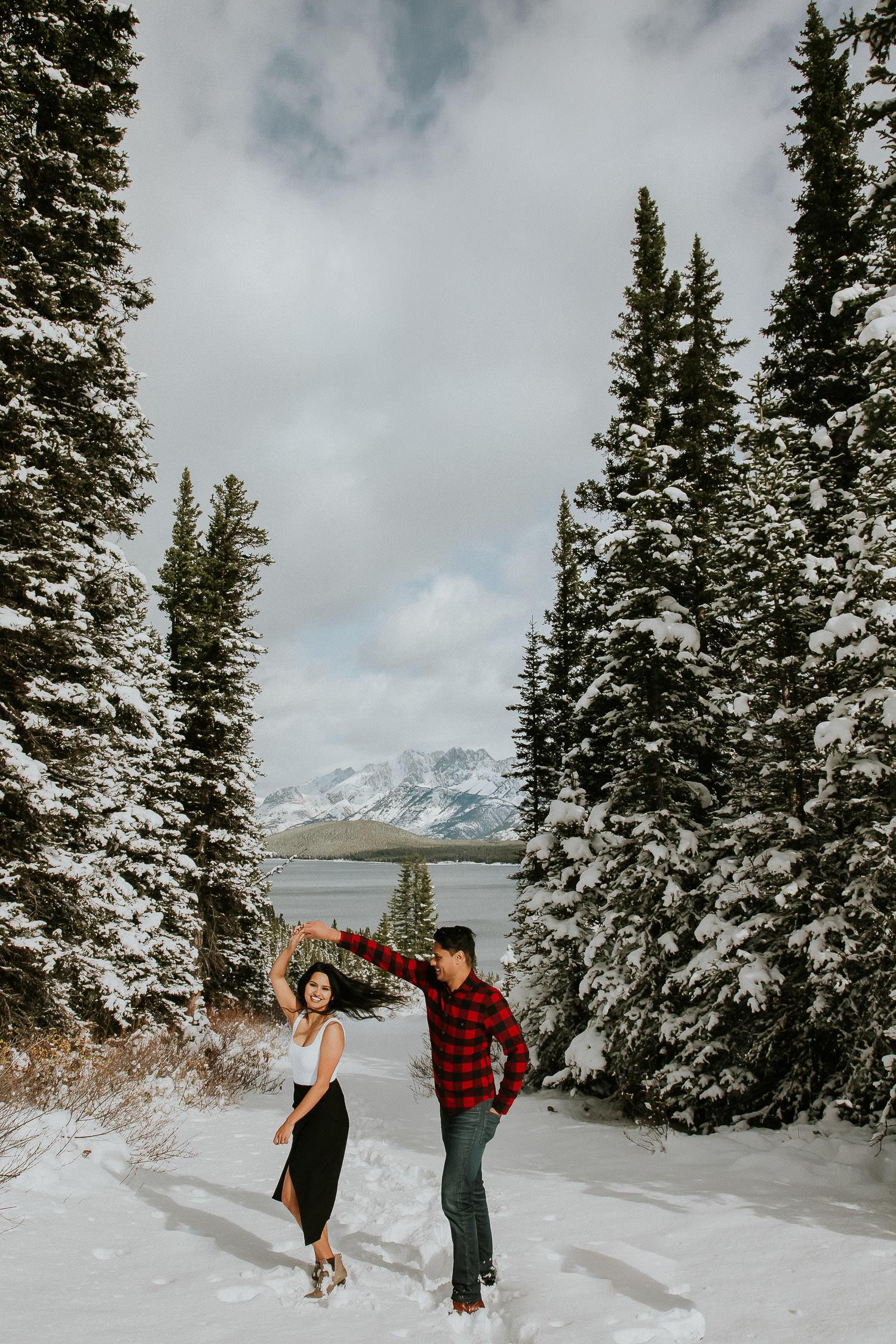 dancing in the snow Kananaskis engagement photos with Sarah pukin