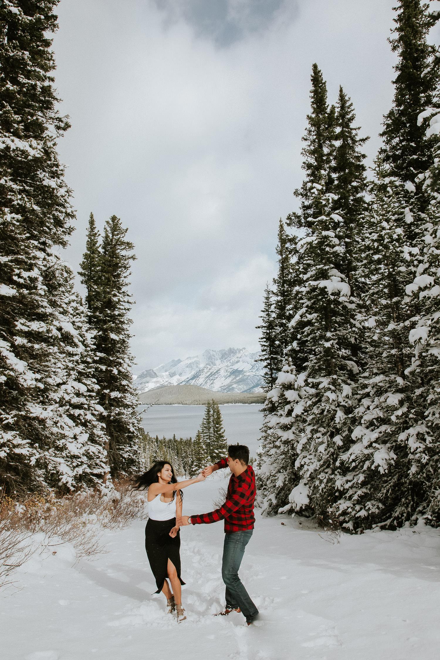 Kananaskis lake engagement photos in the winter - Sarah pukin